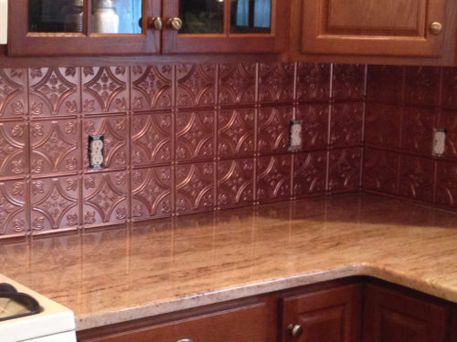 Copper colored tin backsplash