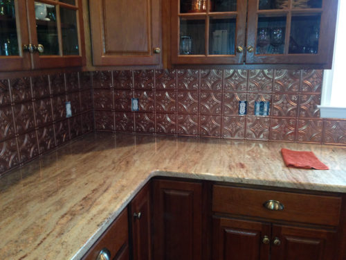 Tin backsplash with copper finish