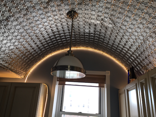 This Living Room Is Now A Topic Of Discussion Among Guests. The Tin Ceilings  Installed On The Arch Walls In The Kitchen Make A Grand Statement.