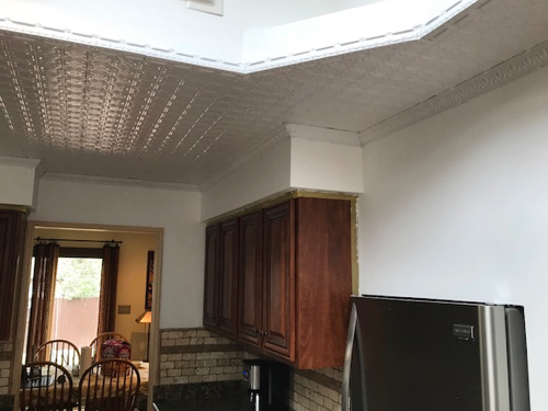 White tin ceiling tiles installation