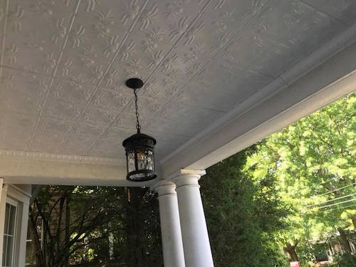 White ceiling tiles on a porch